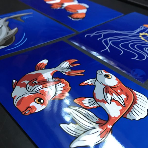 closeup of prints with goldfish focus