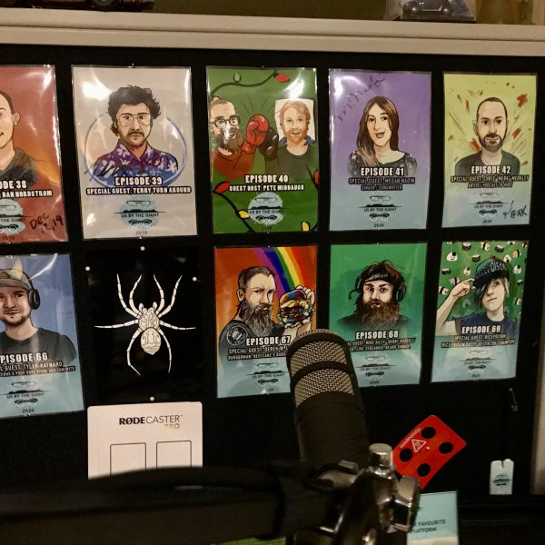 Podcast studio wall showing guest portraits
